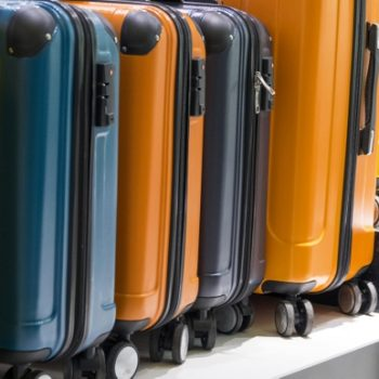 side-view-colorful-suitcases_23-2148255966